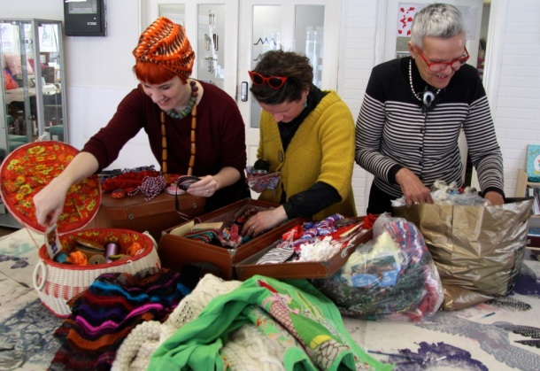 Zara, Alison and Frances sorting through the haberdashery stash