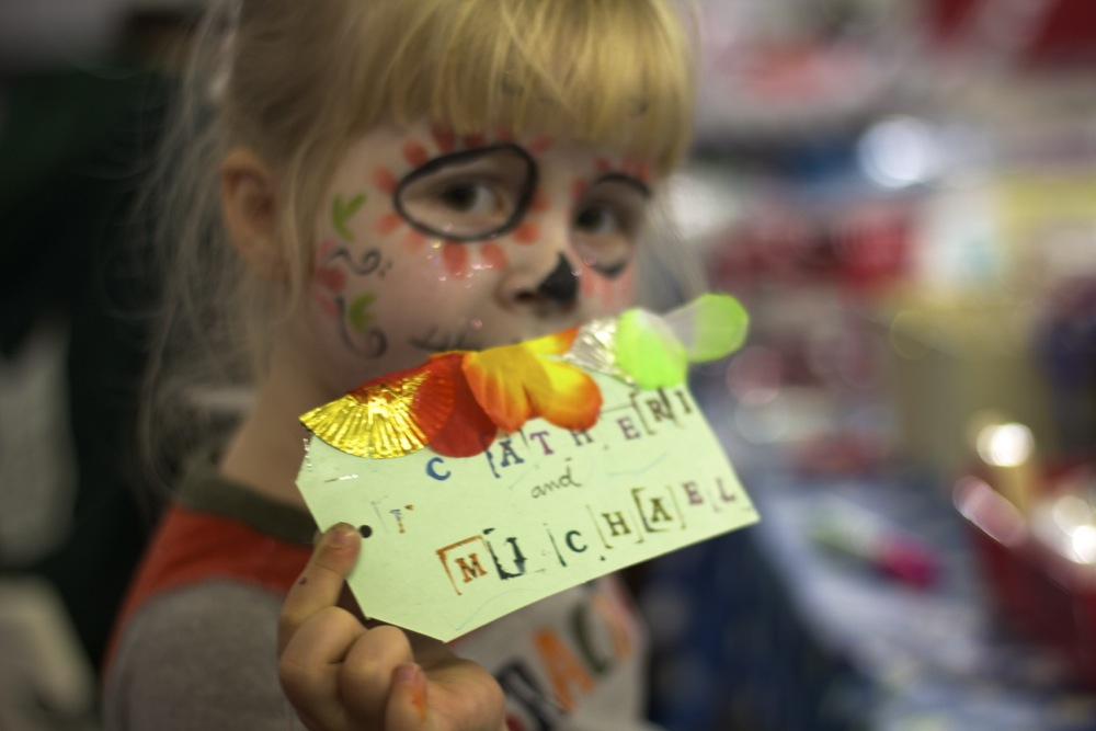 face painted girl with shrine tag