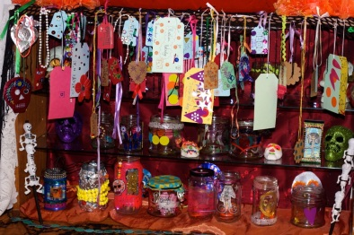 Shrine with memorial tags and decorated glass jars
